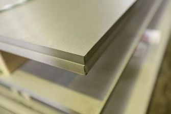 Flat stainless steel sheets stacked on top of each other