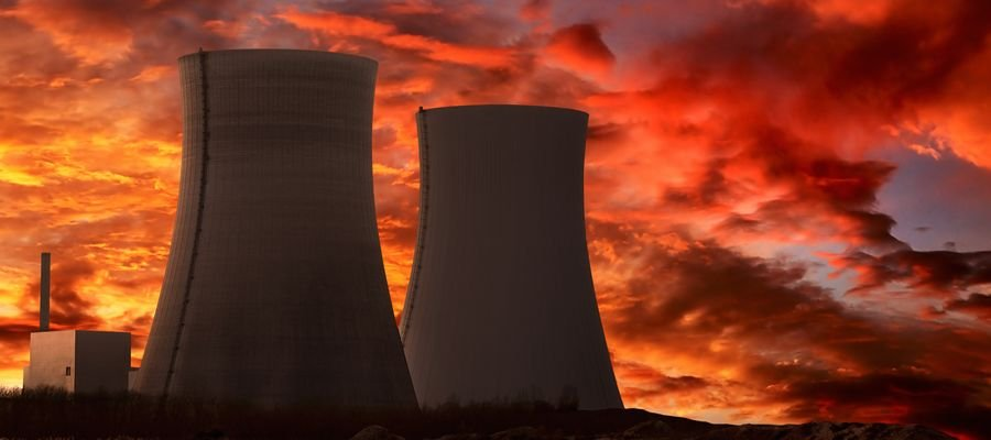 Two nuclear power plants under a sunset
