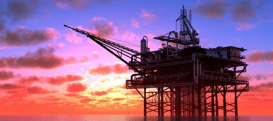 Oil platform under a sunset